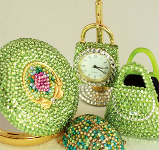 These clocks feature Swarovski ® crystals. They are battery operated and include a replacement battery.
